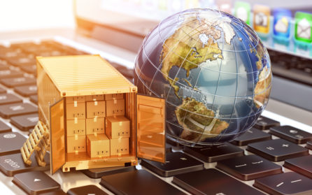 globe and boxes in transportation process on computer