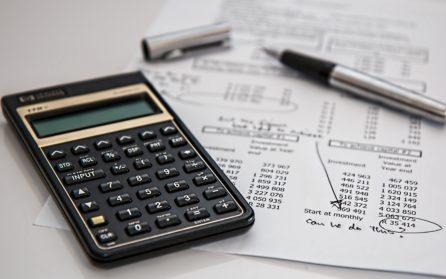calculator and a budget sheet