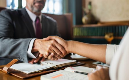 shaking hands with your trusted logistics partner