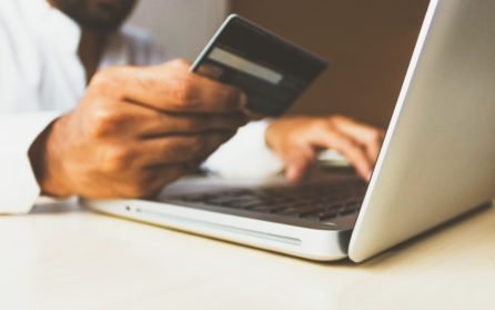 Man making online purchases with a laptop and credit card