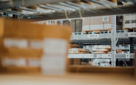 Warehouse shelves stacked with packages and boxes